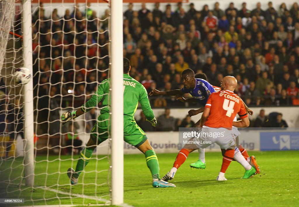 Ramires of Chelsea (C) beats Neil Etheridge and James O'Connor of Walsall (4) to score their first goal during the Capital One Cup third round match between Walsall and Chelsea at Banks's Stadium on September 23, 2015 in Walsall, England.