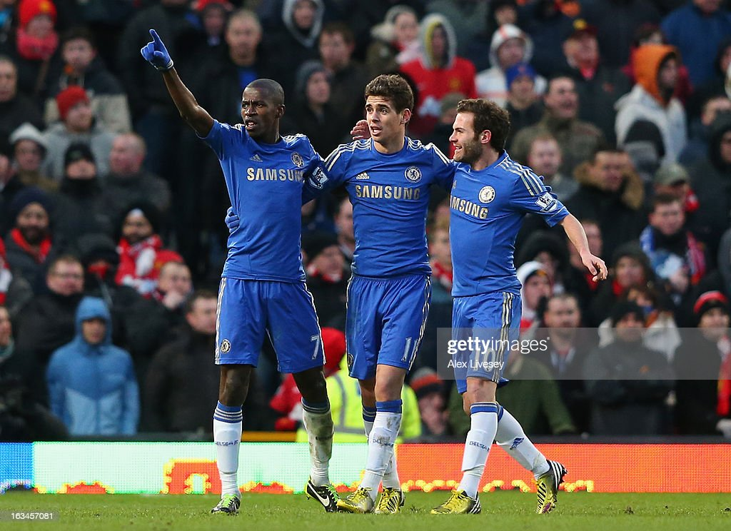 Ramires (l) of Chelsea celebrates scoring his teaam's second goal with team-mates Cesar Azpilicueta and Juan Mata (r) during the FA Cup sponsored by Budweiser Sixth Round match between Manchester United and Chelsea at Old Trafford on March 10, 2013 in Manchester, England.