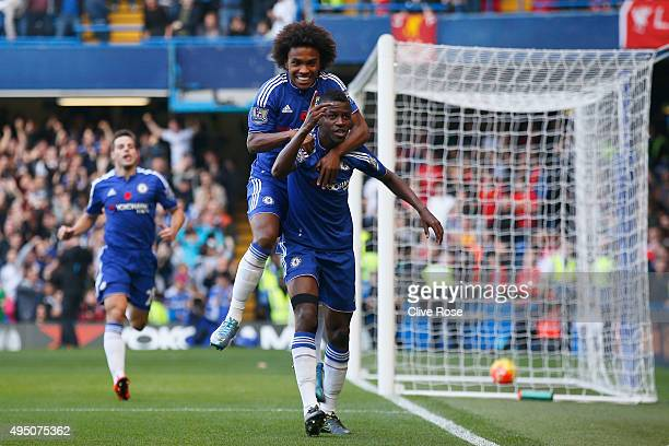 Ramires of Chelsea celebrates scoring his team's first goal with his team mate Willian during the Barclays Premier League match between Chelsea and...