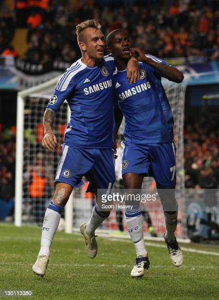Ramires of Chelsea celebrates with Raul Meireles as he scores their second goal during the UEFA Champions League Group E match between Chelsea FC and...