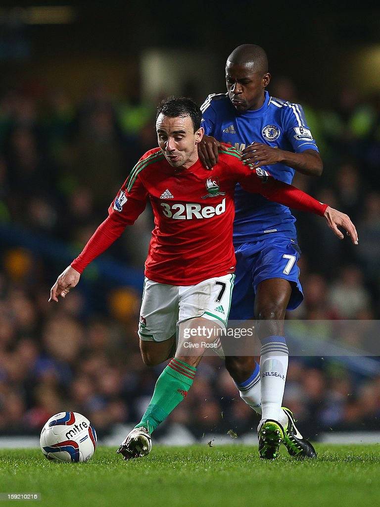 Ramires of Chelsea challenges Leon Britton of Swansea City during the Capital One Cup Semi-Final first leg match between Chelsea and Swansea City at Stamford Bridge on January 9, 2013 in London, England.