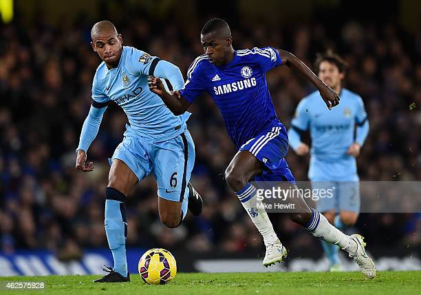 Ramires of Chelsea is challenged by Fernando of Manchester City during the Barclays Premier League match between Chelsea and Manchester City at...