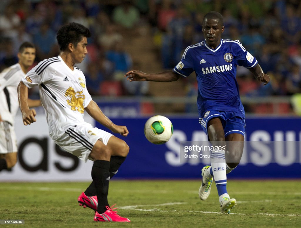 Ramires of Chelsea is checked by Nattaporn of Singha Thailand All-Star XI during the international friendly match between Chelsea FC and the Singha Thailand All-Star XI at the Rajamangala Stadium in Bangkok, Thailand on July 17, 2013 in Bangkok, Thailand.