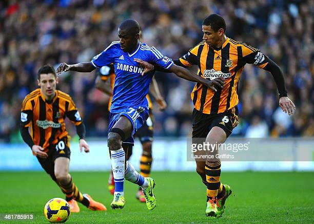 Ramires of Chelsea is closed down by Curtis Davies of Hull City during the Barclays Premier League match between Hull City and Chelsea at KC Stadium...