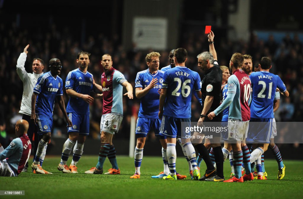 Ramires of Chelsea (3L) is shown a red card and is sent off by referee <a gi-track='captionPersonalityLinkClicked' href=/galleries/search?phrase=Chris+Foy+-+%C3%81rbitro&family=editorial&specificpeople=696483 ng-click='$event.stopPropagation()'>Chris Foy</a> after a challenge on <a gi-track='captionPersonalityLinkClicked' href=/galleries/search?phrase=Karim+El+Ahmadi&family=editorial&specificpeople=2345993 ng-click='$event.stopPropagation()'>Karim El Ahmadi</a> of Aston Villa (L) during the Barclays Premier League match between Aston Villa and Chelsea at Villa Park on March 15, 2014 in Birmingham, England.