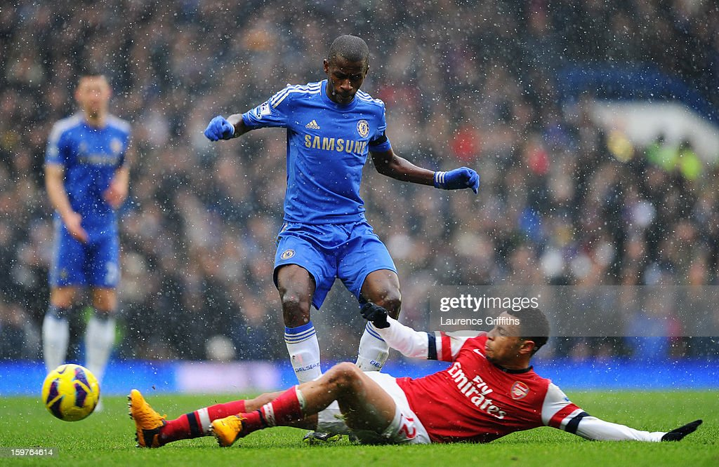 Ramires of Chelsea is tackled by Francis Coquelin of Arsenal during the Barclays Premier League match between Chelsea and Arsenal at Stamford Bridge on January 20, 2013 in London, England.