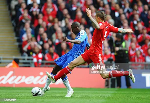 Ramires of Chelsea scores the opening goal under pressure from Daniel Agger of Liverpool during the FA Cup Final with Budweiser between Liverpool and...