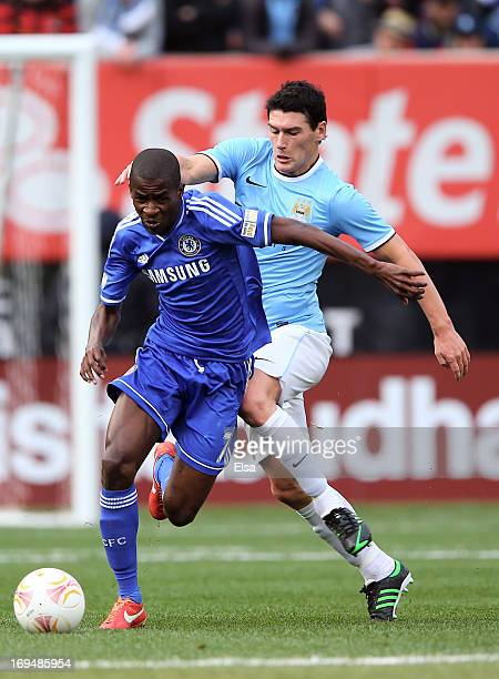 Ramires of Chelsea takes the ball as Gareth Barry of of Manchester City defends at Yankee Stadium on May 25 2013 in the Bronx borough of New York City