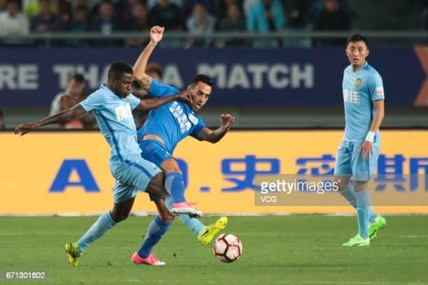 Ramires of Jiangsu Suning and Eran Zahavi of Guangzhou RF compete for the ball during the 6th round match of China Super League between Jiangsu...