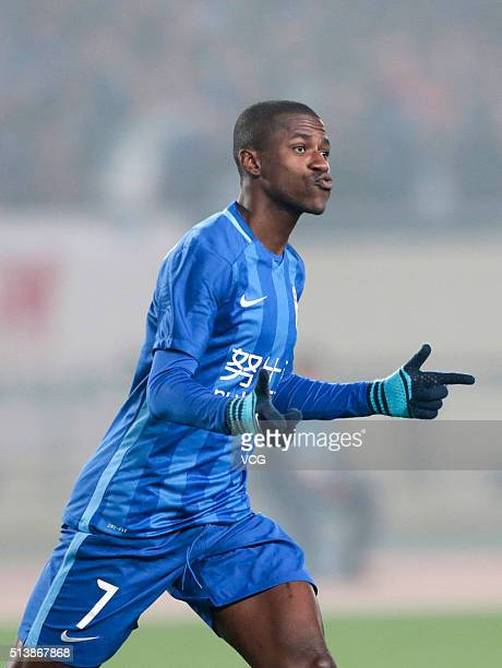 Ramires of Jiangsu Suning celebrates a ball during the first round match of CSL Chinese Football Association Super League between Jiangsu Suning and...