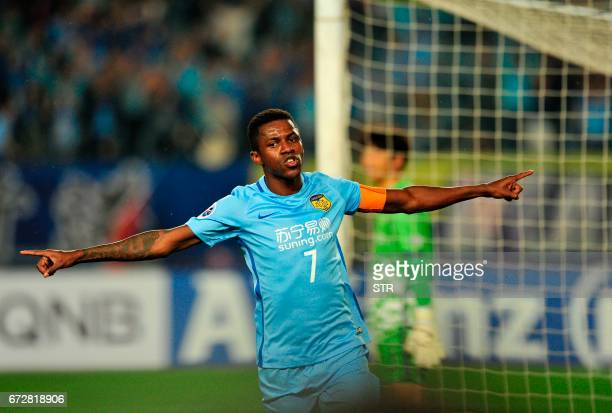 Ramires Santos of Jiangsu FC celebrates after scoring a goal during the AFC Champions League group stage football match against Jeju United FC in...