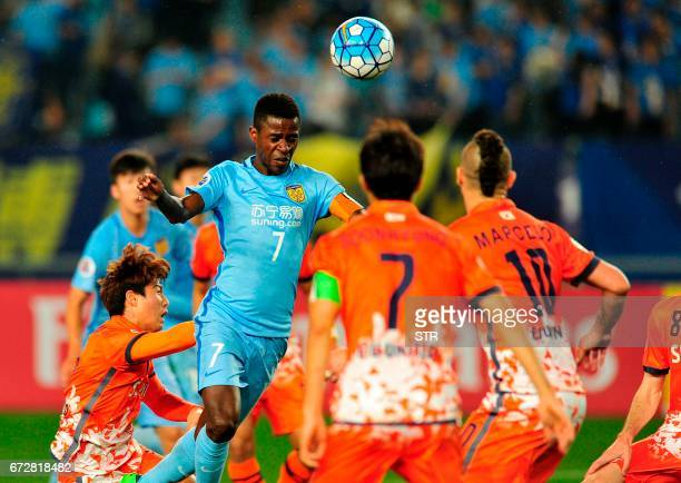 Ramires Santos of Jiangsu FC fights for the ball with Ahn Hyunbeom of Jeju United FC during their AFC Champions League group stage football match in...
