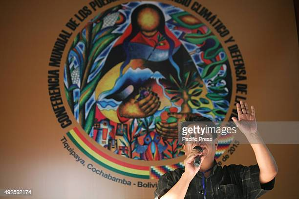 Ramiro Berdeja assists participants at the People's World Conference on Climate Change and the Defense of Life in crafting the final text of a joint...