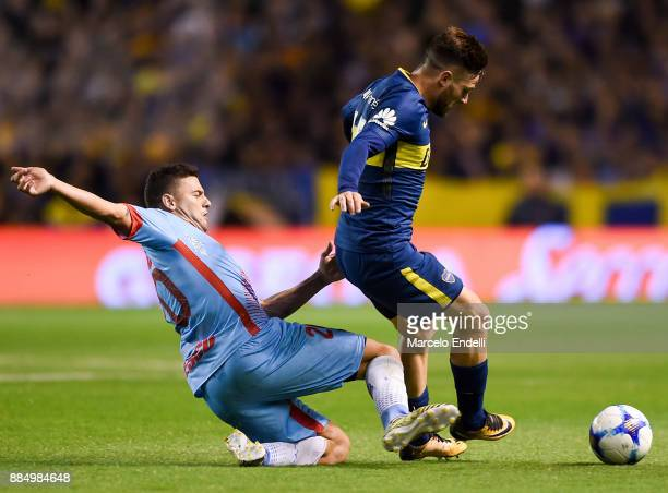 Ramiro Carrera of Arsenal fights for ball with Nahitan Nandez of Boca Juniors during a match between Boca Juniors and Arsenal as part of the...