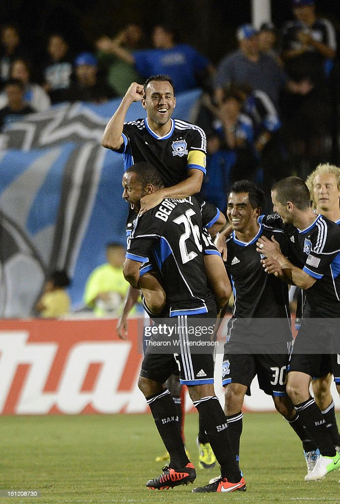 Ramiro Corrales #12, Victor Bernardez #26 and Rafael Baca #30 of the San Jose Earthquakes celebrates after Corrales scored a goal against Chivas USA in the second half of an MLS soccer game at Buck Shaw Stadium on September 2, 2012 in Santa Clara, California. The Earthquakes won the game 4-0.