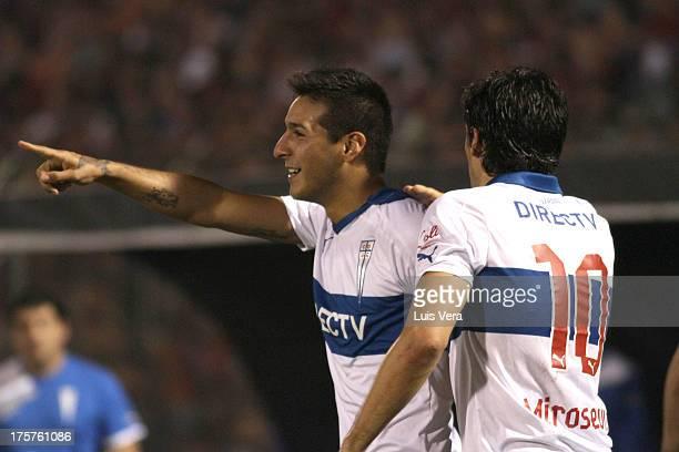 Ramiro Costa and Milovan Mirosevic of Universidad Católica celebrates a scored goal during a match between Cerro Porteño and Universidad Católica as...