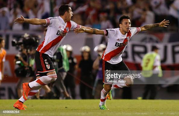 Ramiro Funes Mori and Leonel Vangioni of River Plate celebrate after winning a second leg semifinal match between River Plate and Boca Juniors as...