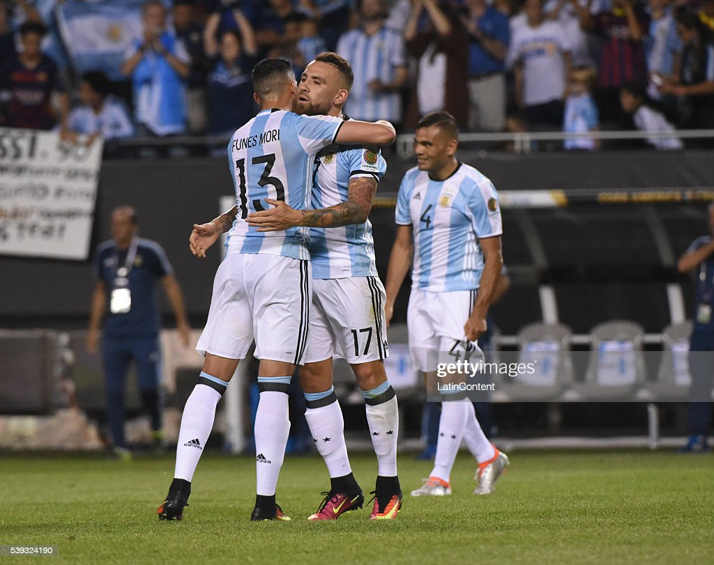 Ramiro Funes Mori and Nicolas Otamendi of Argentina celebrate after a group D match between Argentina and Panama at Soldier Field as part of Copa America Centenario US 2016 on June 10, 2016 in Chicago, Illinois, US.