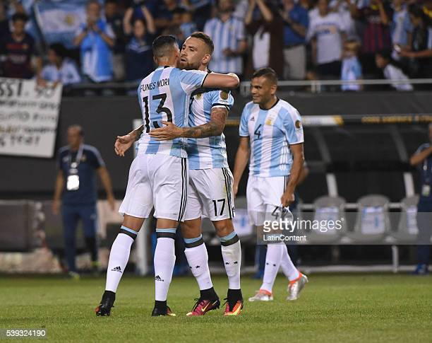 Ramiro Funes Mori and Nicolas Otamendi of Argentina celebrate after a group D match between Argentina and Panama at Soldier Field as part of Copa...