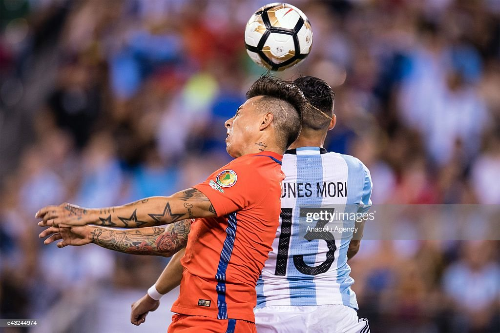 Ramiro Funes Mori (R) of Argentina struggle for the ball against Eduardo Vargas (L) of Chile during the championship match between Argentina and Chile at MetLife Stadium as part of Copa America Centenario 2016 on June 26, 2016 in East Rutherford, New Jersey, USA.