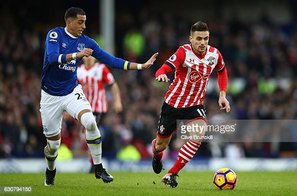 Ramiro Funes Mori of Everton puts pressure on Dusan Tadic of Southampton during the Premier League match between Everton and Southampton at Goodison...