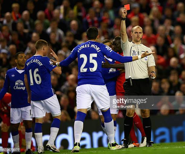 Ramiro Funes Mori of Everton recieves a red card during the Barclays Premier League match between Liverpool and Everton at Anfield April 20 Liverpool...