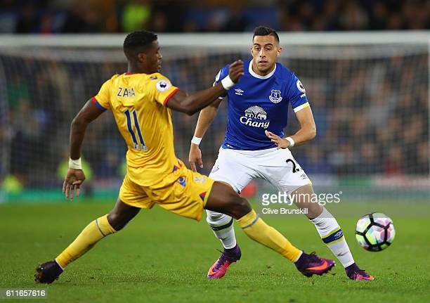 Ramiro Funes Mori of Everton takes on Wilfried Zaha of Crystal Palace during the Premier League match between Everton and Crystal Palace at Goodison...