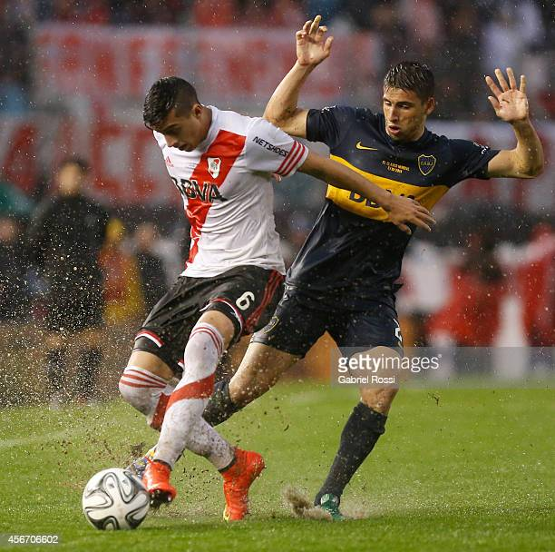 Ramiro Funes Mori of River Plate fights for the ball with Lisandro Magallan of Boca Juniors during a match between River Plate and Boca Juniors as...