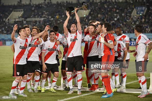 Ramiro Funes Mori of River Plate lifts the trophy as he celebrates with his teammates after winning a match between Gamba Osaka and River Plate at...
