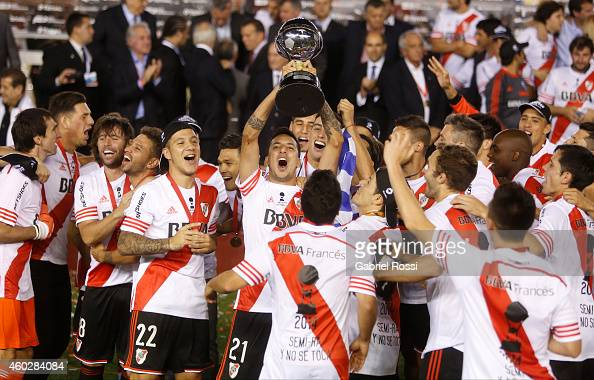 Ramiro Funes Mori of River Plater lifts the Copa Sudamericana trophy after wining the second leg final match between River Plate and Atletico...