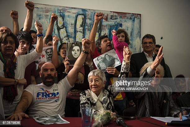 Ramiro Menna brother of the 121st grandson found by the Abuelas of the Plaza de Mayo humanitarian organization gestures next to his aunt and member...