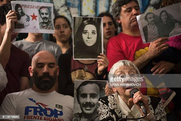 Ramiro Menna brother of the 121st grandson found by the Abuelas of the Plaza de Mayo humanitarian organization listens to his aunt and member of the...