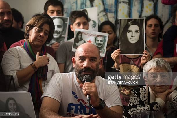 Ramiro Menna brother of the 121st grandson found by the Abuelas of the Plaza de Mayo humanitarian organization speaks next to his aunt and member of...