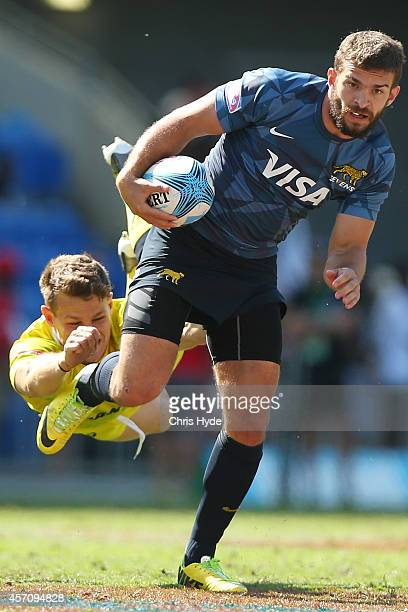 Ramiro Moyano of Argentina is tackled during the 2014 Gold Coast Sevens Plate semifinal match between Argentina and Australia at Cbus Super Stadium...