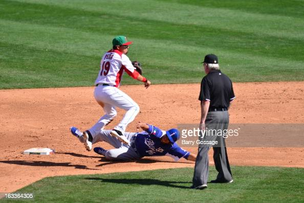 Ramiro Pena of Team Mexico turns a double play as Alex Liddi of Team Italy slides into second base during Pool D Game 1 between Italy and Mexico in...