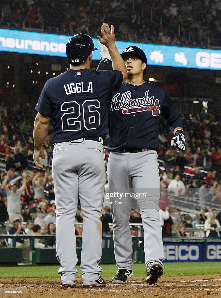 <a gi-track='captionPersonalityLinkClicked' href=/galleries/search?phrase=Ramiro+Pena&family=editorial&specificpeople=809222 ng-click='$event.stopPropagation()'>Ramiro Pena</a> #14 of the Atlanta Braves celebrates with <a gi-track='captionPersonalityLinkClicked' href=/galleries/search?phrase=Dan+Uggla&family=editorial&specificpeople=542208 ng-click='$event.stopPropagation()'>Dan Uggla</a> #26 after hitting the go ahead two RBI home run in the tenth inning to give the Braves a 6-4 win over the Washington Nationals at Nationals Park on April 12, 2013 in Washington, DC.