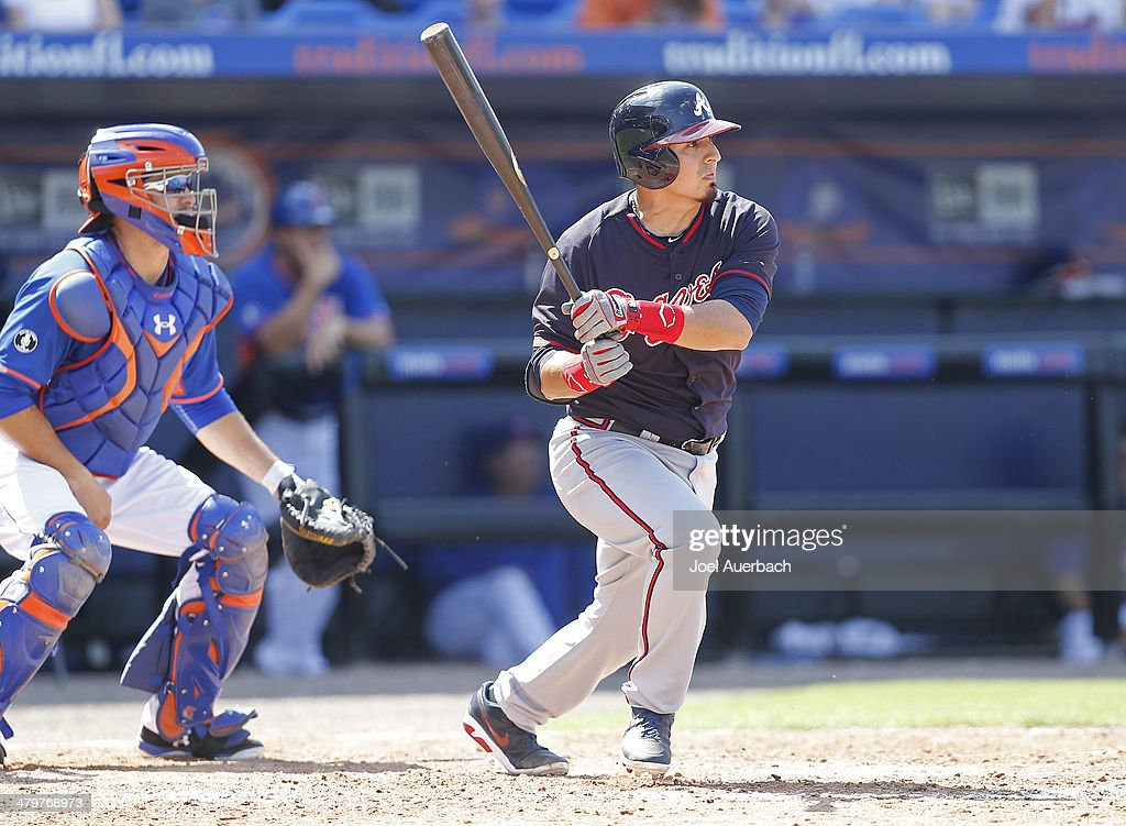 <a gi-track='captionPersonalityLinkClicked' href=/galleries/search?phrase=Ramiro+Pena&family=editorial&specificpeople=809222 ng-click='$event.stopPropagation()'>Ramiro Pena</a> #14 of the Atlanta Braves hits a single scoring a run in the seventh inning against the New York Mets during a spring training game at Tradition Field on March 20, 2014 in Port St. Lucie, Florida. The Mets defeated the Braves 7-6.