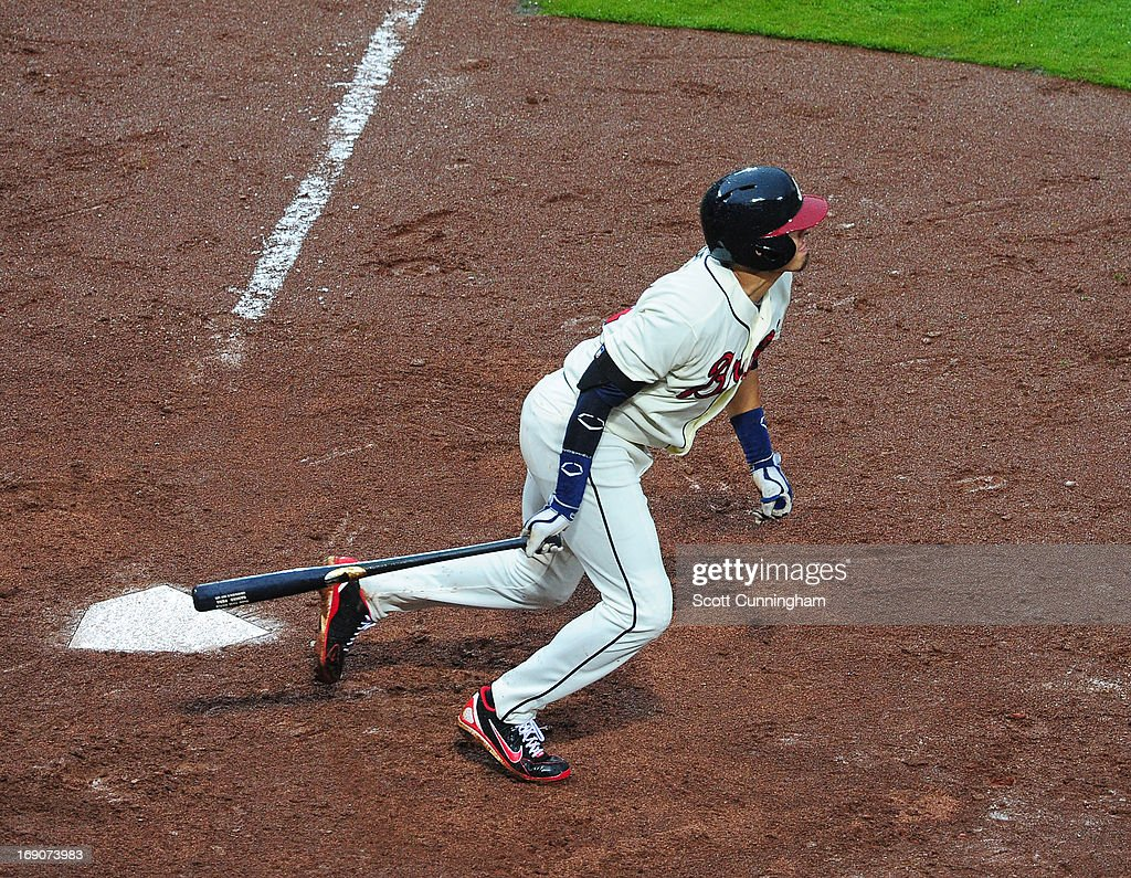 <a gi-track='captionPersonalityLinkClicked' href=/galleries/search?phrase=Ramiro+Pena&family=editorial&specificpeople=809222 ng-click='$event.stopPropagation()'>Ramiro Pena</a> #14 of the Atlanta Braves hits an eighth inning sacrifice fly to knock in the go-ahead run against the Los Angeles Dodgers at Turner Field on May 19, 2013 in Atlanta, Georgia.