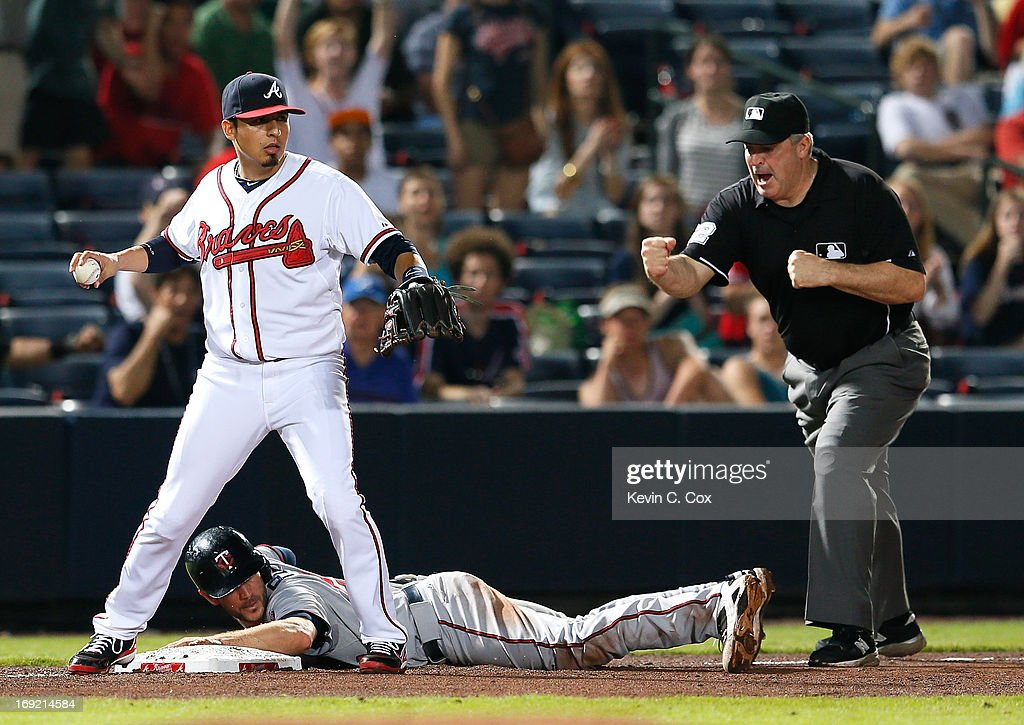 <a gi-track='captionPersonalityLinkClicked' href=/galleries/search?phrase=Ramiro+Pena&family=editorial&specificpeople=809222 ng-click='$event.stopPropagation()'>Ramiro Pena</a> #14 of the Atlanta Braves tags out <a gi-track='captionPersonalityLinkClicked' href=/galleries/search?phrase=Trevor+Plouffe&family=editorial&specificpeople=5722348 ng-click='$event.stopPropagation()'>Trevor Plouffe</a> #24 of the Minnesota Twins in the eighth inning at Turner Field on May 21, 2013 in Atlanta, Georgia.