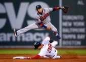Ramiro Pena of the Atlanta Braves turns a double play over Grady Sizemore of the Boston Red Sox during the game at Fenway Park on May 28 2014 in...