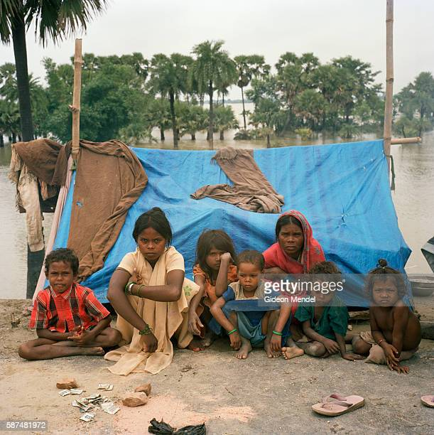 Ramjyoti Devi and Jaikali Deviin and their children in front of their makeshift plastic shelter set up on a road embankment in east Champaran They...