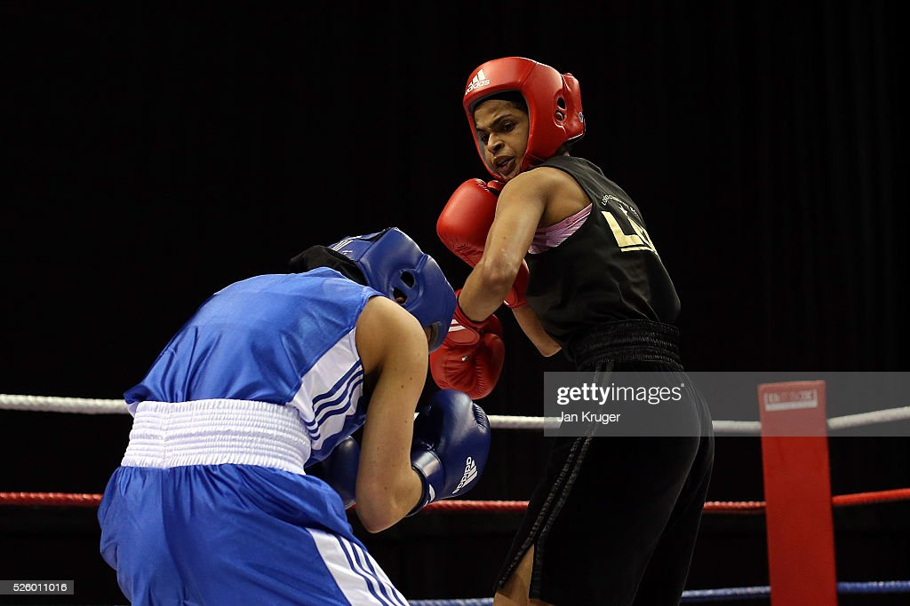 Ramla Ali(red) in action against Chloe Jade Pearce in their 54kg fight during day one of the Boxing Elite National Championships at Echo Arena on April 29, 2016 in Liverpool, England.
