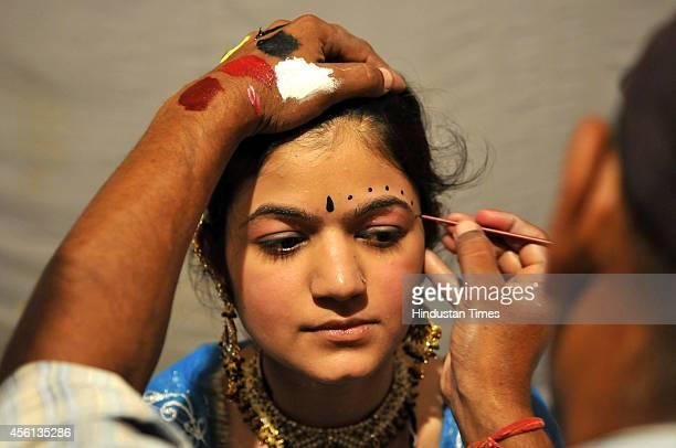 Ramlila actors getting ready backstage at Noida stadium on September 25 2014 in Noida India Ramlila is a dramatic folk reenactment of the life of...