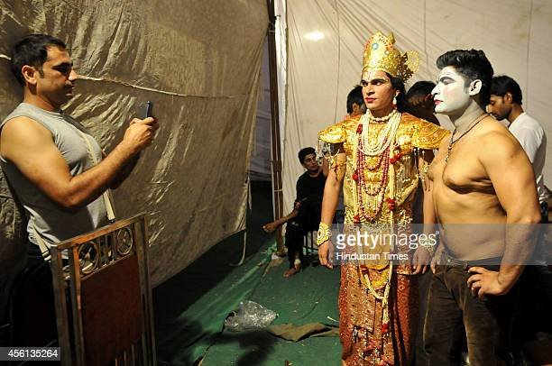 Ramlila actors pose for photograph backstage before their performance at Noida stadium on September 25 2014 in Noida India Ramlila is a dramatic folk...