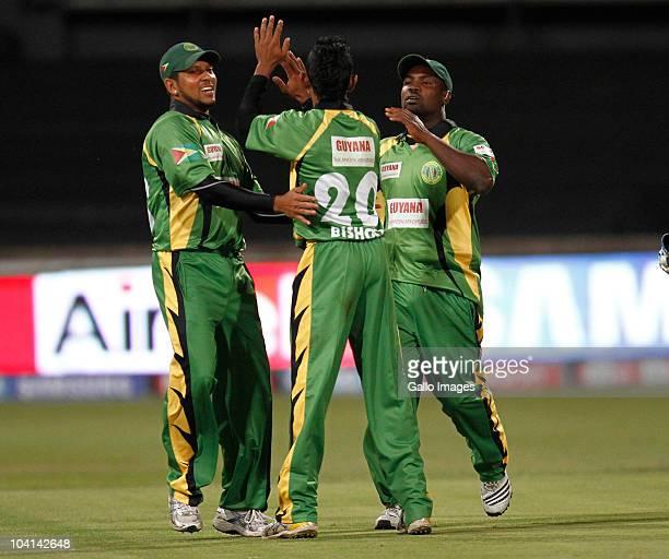 Rammaresh Sarwan of Guyana celebrates with teammate Devendra Bishoo during the Airtel Champions League Twenty20 match between Mumbai Indians and...