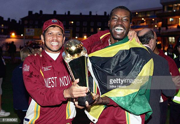 Ramnaresh Sarwan and Chris Gayle of West Indies celebrate winning the Final of the ICC Champions Trophy between England and West Indies on September...