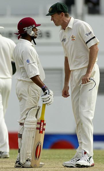 Ramnaresh Sarwan of the West Indies and Glenn McGrath of Australia confront each other : News Photo