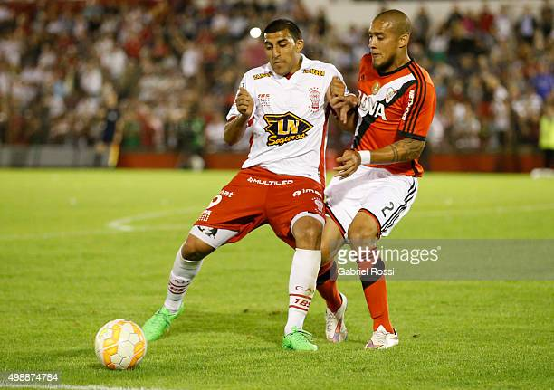 Ramon Abila of Huracan fights for the ball with Jonathan Maidana of River Plate during a second leg match between Huracan and River Plate as part of...