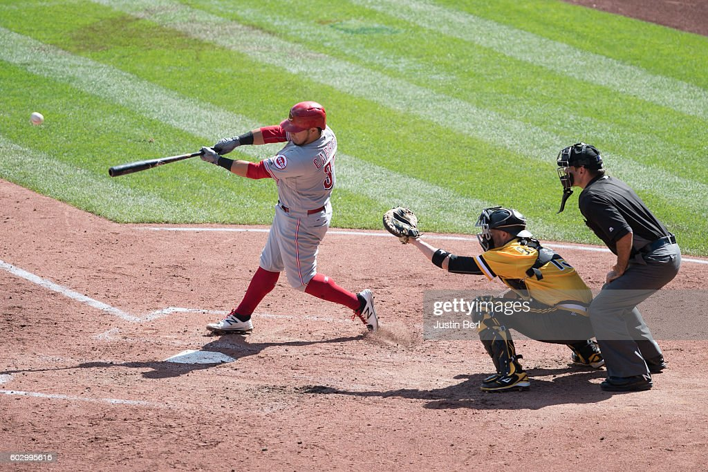 Ramon Cabrera #37 of the Cincinnati Reds hits an RBI single to center field in the fifth inning during the game against the Pittsburgh Pirates at PNC Park on September 11, 2016 in Pittsburgh, Pennsylvania.