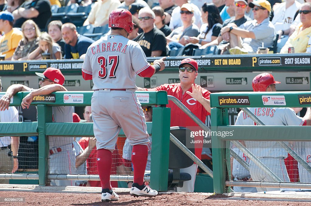 Ramon Cabrera #37 of the Cincinnati Reds is greeted by manager Bryan Price #38 after coming around to score in the second inning during the game against the Pittsburgh Pirates at PNC Park on September 11, 2016 in Pittsburgh, Pennsylvania.